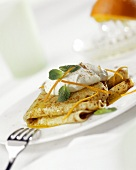 Crepes suzettes with cream and mint