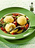 Pepper soup with polenta and sheep's cheese dumplings