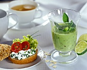 Kiwi fruit drink and bread with chive quark for breakfast