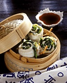 Japanese sole rolls in bamboo steamer