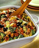 Potato gratin with broccoli, olives and tomatoes