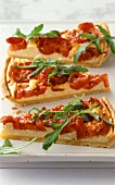 Tomato tart with rocket, cut into pieces