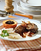 Beef roulades with napkin dumpling and baked apple