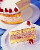Raspberry gateau with icing sugar