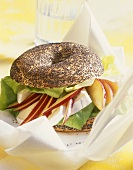 Poppy seed bagel with lettuce, Camembert and peach