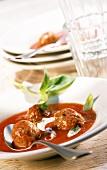 Tomato soup with meatballs and crème fraiche