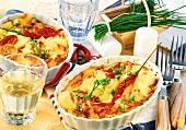 Baked cheese with tomatoes, chili peppers and chives
