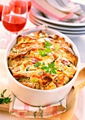 Pancakes with vegetables in baking dish
