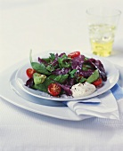 Spinach and avocado salad with cherry tomatoes and sour cream