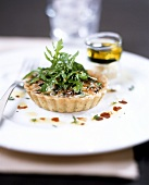 Olive tartlet with rocket and olive oil
