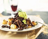 Beef fillet with bacon, roast potatoes and avocado puree