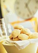 Bread rolls on white cloth in kitchen