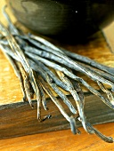 Vanilla pods on wooden crate