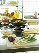 Kitchen scene with various ingredients for wok dish
