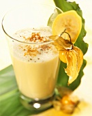 Banana and pomelo smoothie with cinnamon and physalis