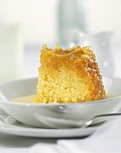 Piece of ring cake with honey sauce