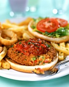 Vegetable burger with tomato sauce and chips