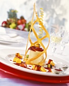 Vanilla cream tower with fried fruit and wafer