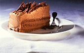 Piece of chocolate cream gateau with chocolate curls