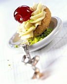 Biscuit with pistachio cream and cocktail cherry