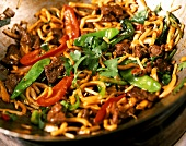 Beef curry with vegetables in wok