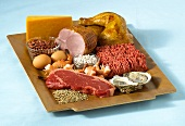 Foods rich in zinc on tray (meat, oysters etc)