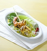 Kebab with grilled shrimp and scallop on vegetables