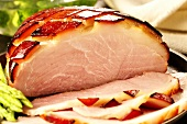 Glazed roast ham, a slice cut