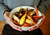 Person holding dish of bouillabaisse