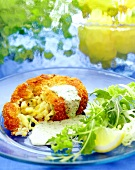 Fish cake with herb sauce, lettuce and lemon