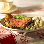 Beef steak with mashed potato and green beans