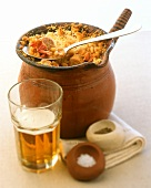 English cassoulet in terracotta pot, beer and spices