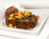 Steak with pepper and mango salsa