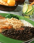 Feijoada with meat, black beans and rice from Brazil