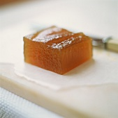 A cube of quince jelly