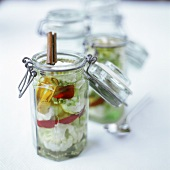 Pickled cauliflower with spices in pickling jar