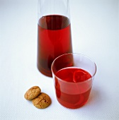 Raspberry and cranberry juice with amaretti