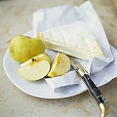 Camembert and green apple on plate