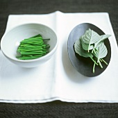 Chives and basil in bowls