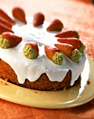 Carrot cake with glacé icing and marzipan carrots