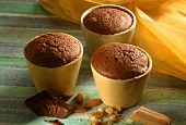 Small chocolate soufflés in yellow moulds