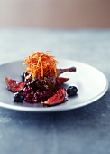Glazed duck leg with red cabbage and figs