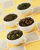 Various types of tea in cups and tea bags