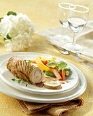 Turkey roulade with leek filling and vegetables
