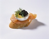 Canapé with salmon, egg and caviare