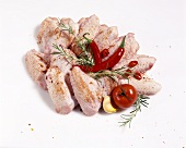 Chicken wings with chilis, rosemary and tomato