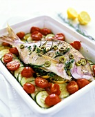 Sea bream, Mediterranean style, with tomatoes and courgettes