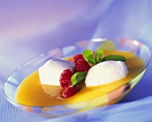 Apricot soup with buttermilk mousse, raspberries and mint