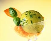 Basil and mango sorbet in dessert bowl