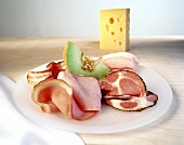 Platter of ham with sweet melon; cheese